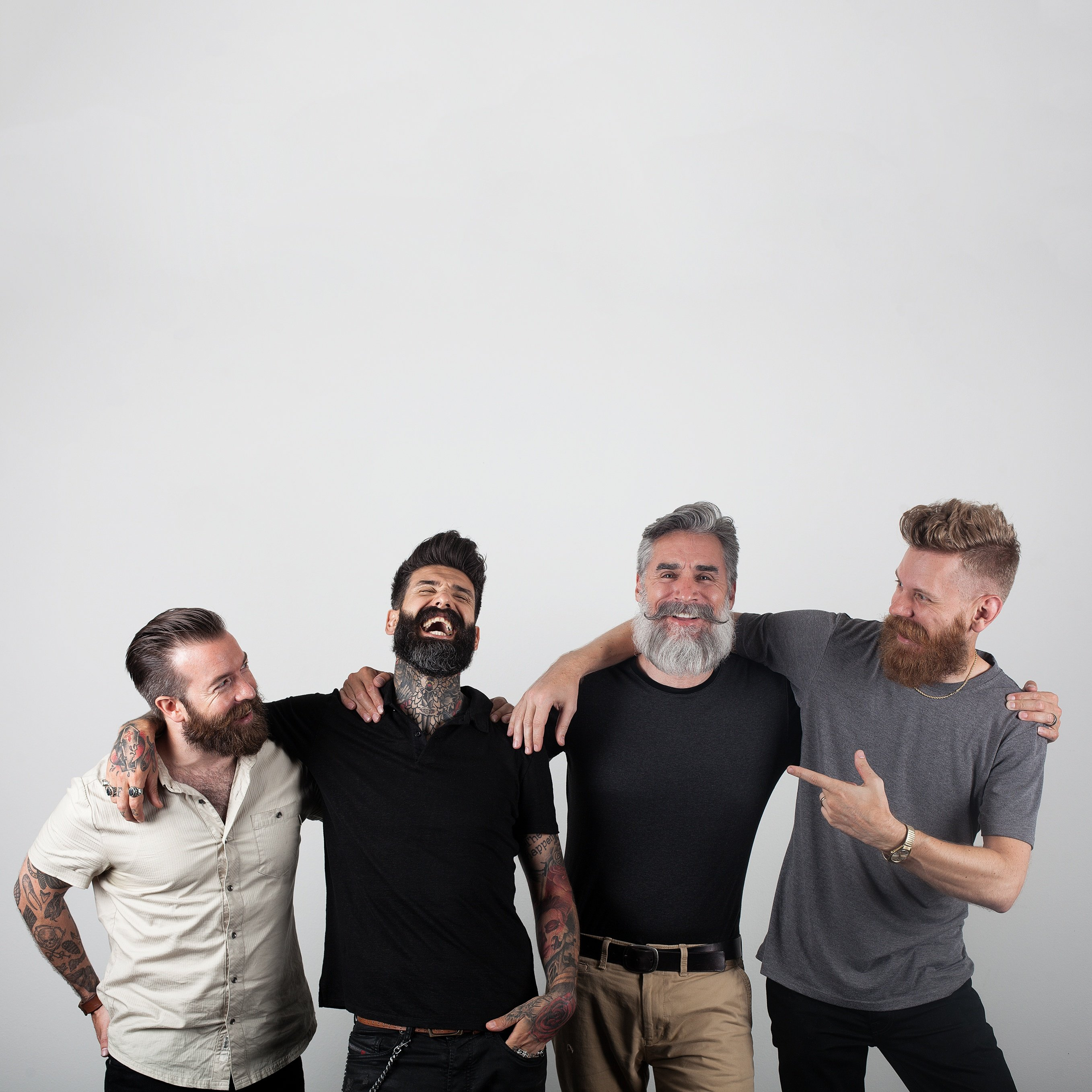 Four men with excellent beards enjoying camaraderie