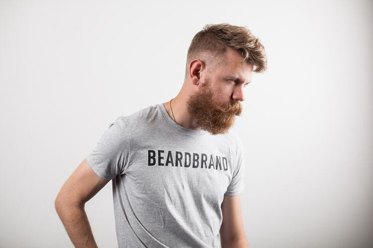 Man with long beard wearing a Beardbrand t-shirt